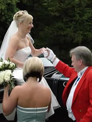 English toastmaster Richard Palmer assisting a bride from a horse drawn carraige